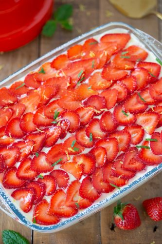 Overhead view of top decoration with sliced strawberries.