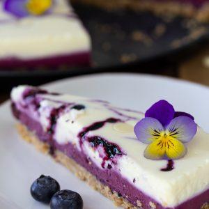 Blueberry white chocolate cheesecake sliced.