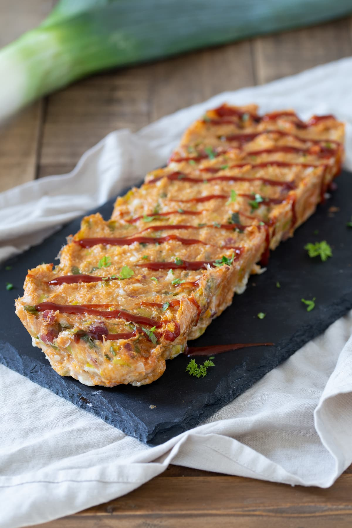 Chicken meatloaf drizzled with BBQ sauce.