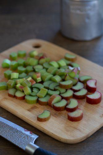Chopped rhubarb stalks on a cutting board.