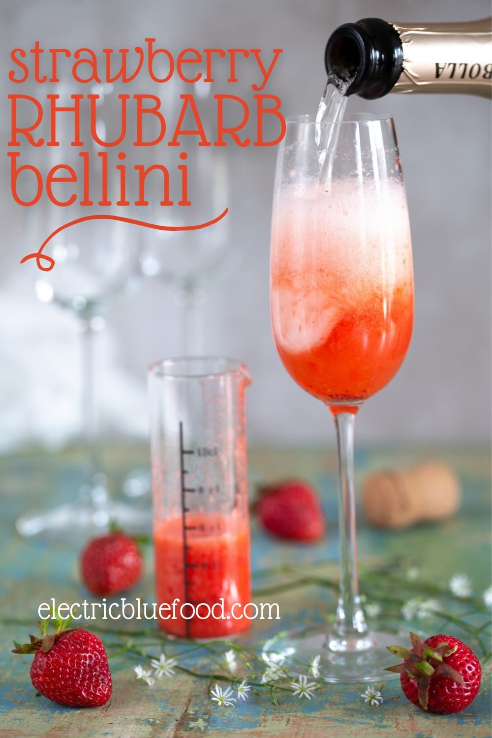 Strawberry rhubarb Bellini (rhubrb Rossini) a Prosecco cocktail with rhubarb syrup and strawberry purée.