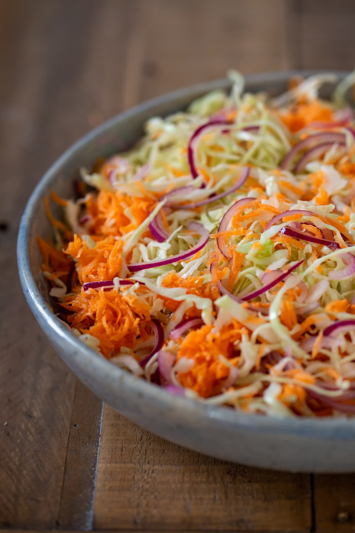 Slaw resting with the condiment.