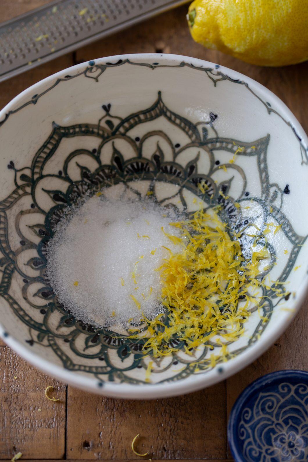 Mandala bowl with granulated sugar and lemon zest.