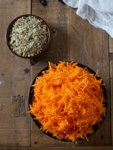 Grated carrots and crushed seeds.