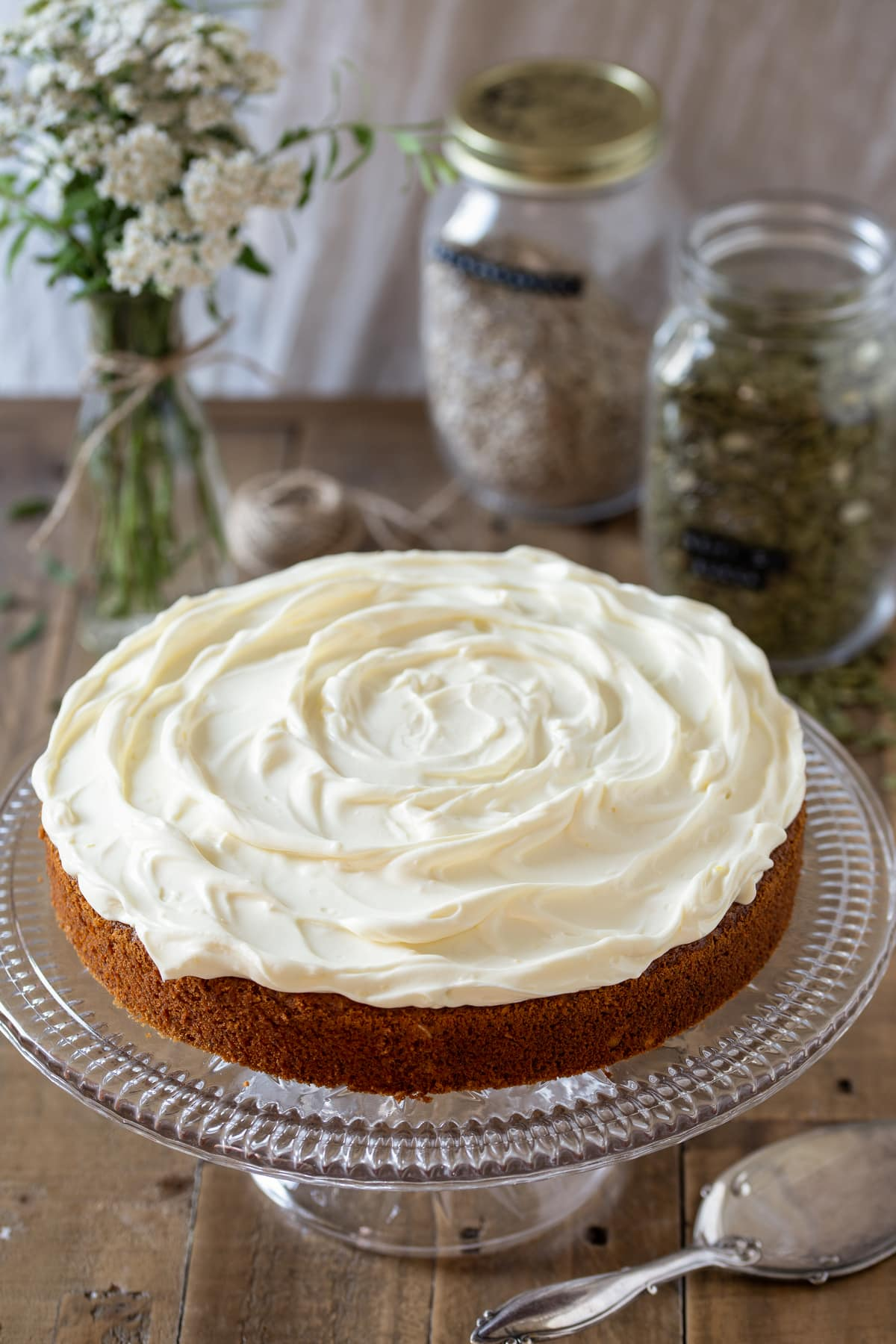 Carrot cake with cream cheese frosting on top.