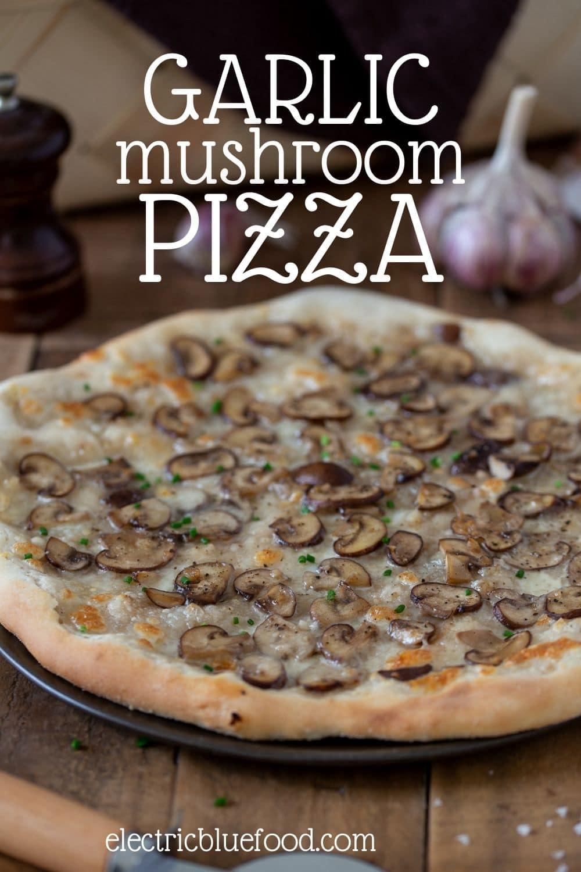 Garlic mushroom pizza bianca topped with mozzarella and garlic mushrooms sautéed in butter.