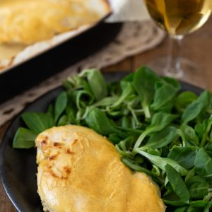 Baked mustard chicken served with salad.