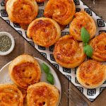 Puff pinwheels filled with tomato and mozzarella and topped with parmesan and oregano.