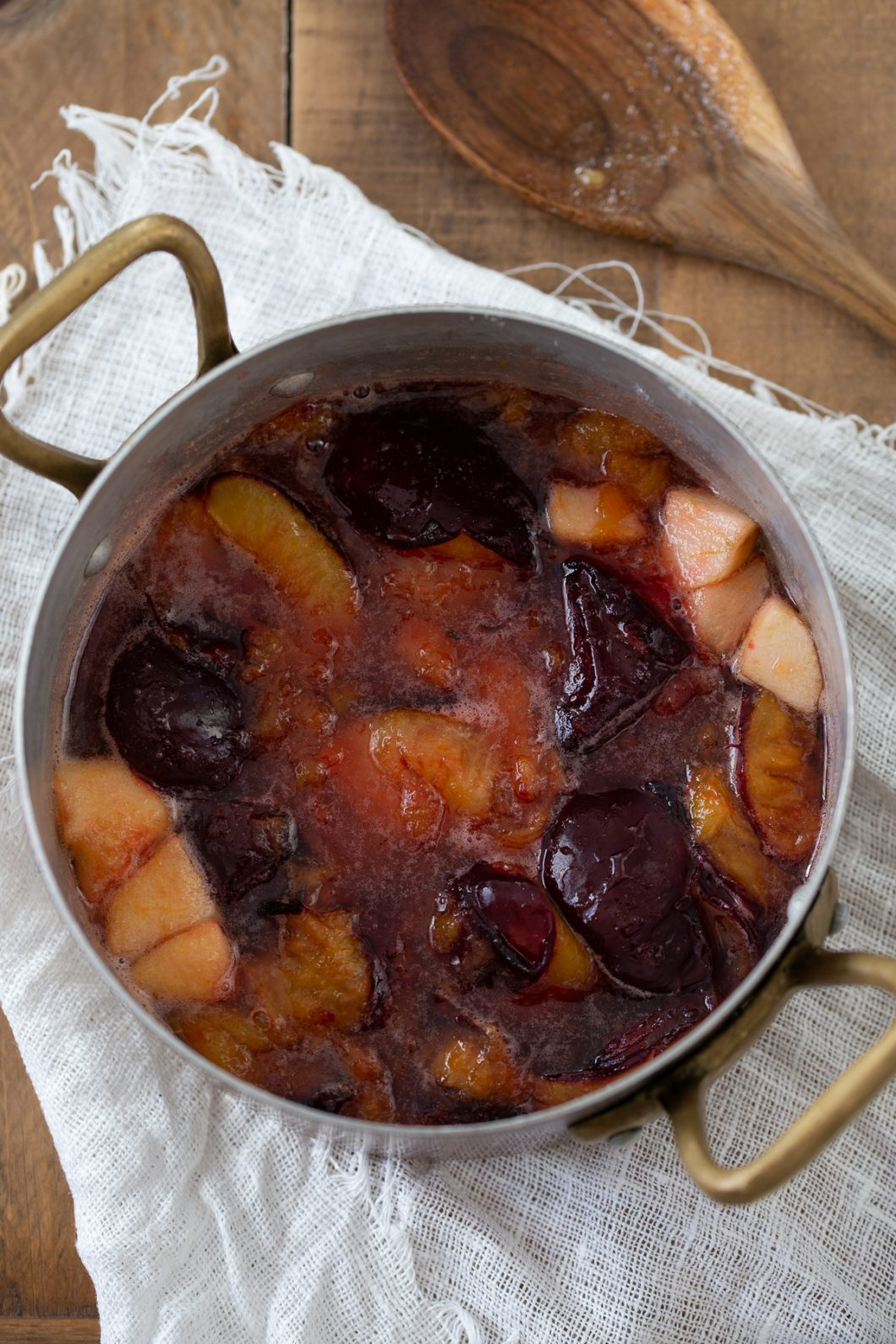 Cooked plums and apples.
