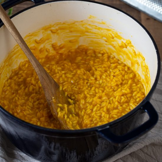 Saffron risotto in a Dutch oven pot.